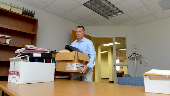 Andy Potter, the new chief of staff for the Michigan Corrections Organization, moves boxes from his old ofice to his new office in Lansing on Wednesday.
