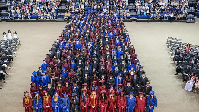 Asheville High and SILSA classes of 2015 graduates celebrate their commencement at UNCA's Kimmel Arena on Friday night. About 300 students graduated from the city schools surrounded by teachers, friends and family.