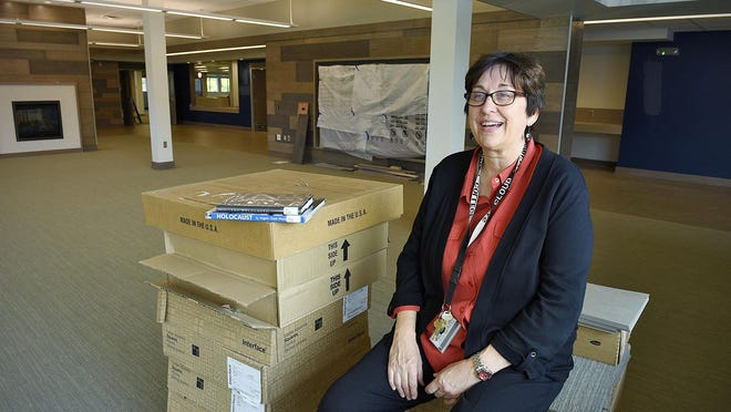 Vi Bergquist, chief information officer, talks Wednesday about the features in the new media center under construction at St. Cloud Technical and Community College.
