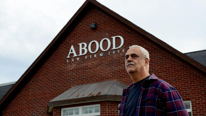 David Zarka stands in front of the Abood Law Firm, established in 1956. The Aboods are just one example of a well-respected family of Lebanese or Syrian descent who have been in the Lansing area for decades as local business owners, neighbors and friends.