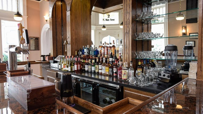 The bar area of the Inn at Duck Creek in Smyrna is fully stocked as final finishing touches are performed in preparation for opening to the public.