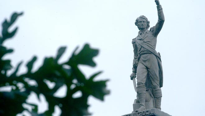 A statue of Ethan Allen sits at his grave site at the Greenmount Cemetery off Colchester Avenue in Burlington.