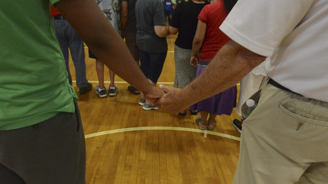 Campbell Street Church of Christ held a community prayer service and prayer walk July 20 at North Side High School.