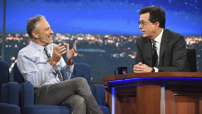 """Guest Jon Stewart , left, speaks with host Stephen Colbert on """"The Late Show with Stephen Colbert,"""" during the television show in New York. It was a rare TV reunion Tuesday as Colbert played host to a gang of his fellow """"Daily Show"""" alums, including Stewart, on a special edition of CBS's """"The Late Show."""""""