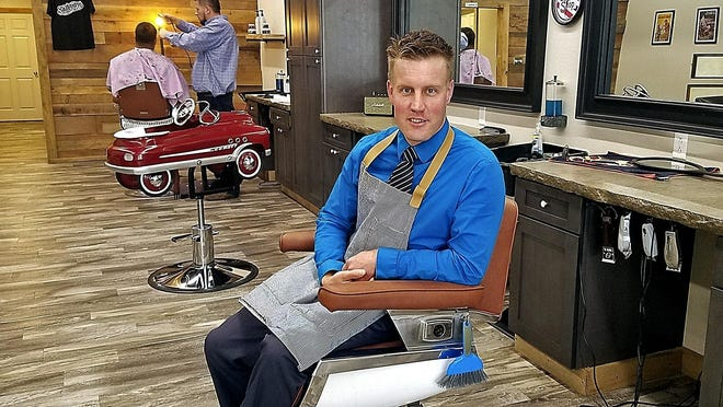 """TOP: Gavin Varley sits in a restored chair from the 1950s for his new barbershop in Monongahela, Pa. He said barbers are in demand and newer shops are serving customers who want a 1920s-style cut that involves closely trimmed sides and longer on top. Back then, men went to a barber every two weeks to get a shave, trim and catch up on the local gossip. """"It's changing back to that,"""" he said. Photos by Scott Beveridge/Observer-Reporter via Ap"""