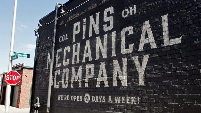 The exterior of Pins Mechanical Company, one of several Columbus bars and restaurants that on Wednesday, Aug. 5, 2020 unsuccessfully  sought a temporary restraining order against the state Liquor Control Commission's emergency 10 p.m. halt to liquor sales and 11 p.m. end to liquor consumption on premises. Gov. Mike DeWine asked the commission for the order to slow down the spread of the COVID pandemic in Ohio. The lawsuit filed by the bar and restaurant owners continues.