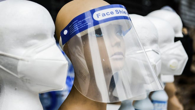 Face shields and masks for sale in New York on March 23.