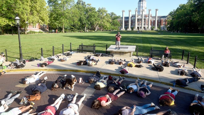 About 100 protesters lie Wednesday in the drive at Francis Quadrangle on the University of Missouri campus. The protesters marched on Eighth Street from the courthouse to the Francis Quadrangle and back again while protesting the killing of George Floyd by a police officer in Minneapolis.