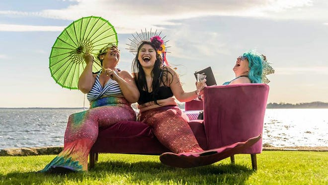 Brenda Santos, Sandra Victorino and Lisa Peterson, friends since they met on a bus to the Women's March in Washington, meet regularly to laugh. All are in helping professions. Here, they share a velvet couch in Bristol.