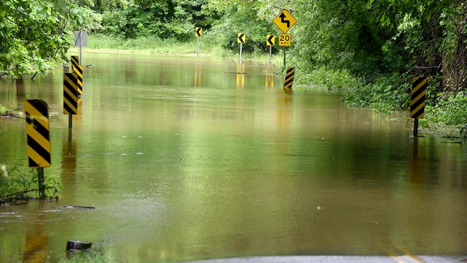 Floodwater from Bear Creek covers Blackfoot Road on Tuesday in western Boone County. The remnants of Tropical Storm Cristobal dropped 2 to 3 inches of rain across central Missouri, flooding many low-lying roads.