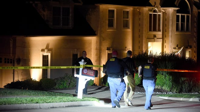 Columbia detectives and crime scene investigators arrive at a house in the 6000 block of Bentpath Drive about 10 p.m. Wednesday following a report of a burglary with shots fired. The owner of the home shot two burglars, killing one and wounding the other.