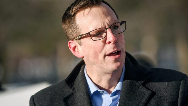 State Rep. Jon Hoadley, D-Kalamazoo, voices his opposition to President Donald Trump during a Michigan Democratic Party event at Friendship Park ahead of President Trump's Merry Christmas rally on Wednesday, Dec. 18, 2019, in Battle Creek.191218 Trump 052a