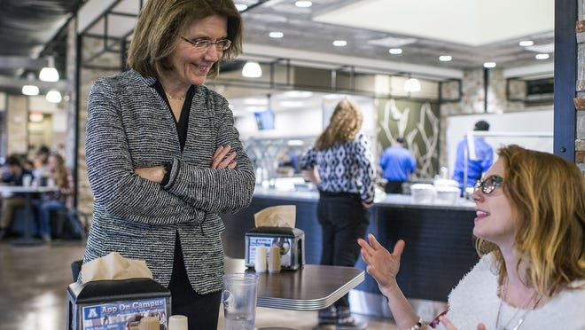 UNC Asheville Chancellor Mary K. Grant, left, speaks with student Sydney McRoy of Raleigh.