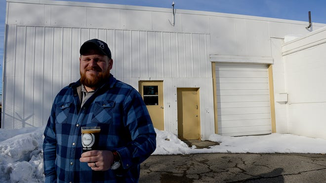 Eric Elliott, co-owner of Ellison Brewery stands outside the Meridian Township warehouse where the brewery will operate Wednesday, February 25, 2015. He said he hopes to have everything operational and open by August.