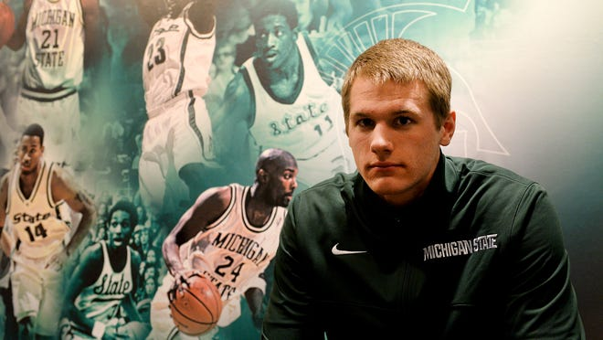 Due to NCAA restrictions, Matt Van Dyk, a junior forward for the Spartans, has largely been kept in the shadows of the team - able to practice, workout and interact with the team, but unable to travel and play. He started his college career at Hope College after graduating from Imlay City High School, but then transferred to a community college before transferring to, and earning a walk-on spot, at MSU.