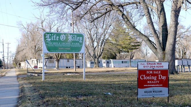 "A ""for sale"" sign sits on the property of the Life O'Riley Mobile Home Park & Campground on South Washington Avenue in Lansing this week. The park was shut down in February 2014 by the Ingham County Health Department for unsanitary conditions. It remains closed."