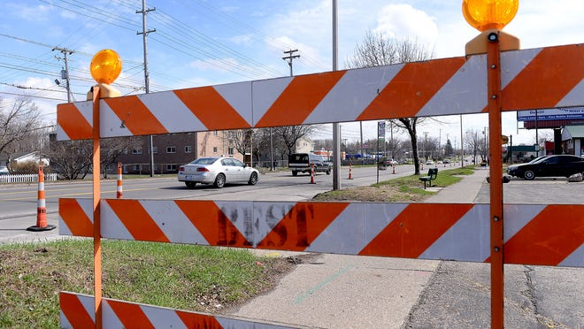 Traffic slows on Martin Luther King Boulevard on April 13 as a southbound lane is closed for road work south of Holmes Road in Lansing.