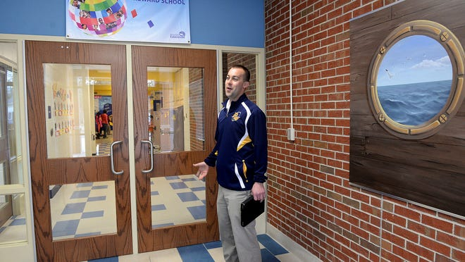 Pewamo-Westphalia Superintendent Jason Mellema stands in, and talks about, the public entrance to the elementary school on April 2. During school hours parents, members of the public, and others can enter the front of the school and get to this area, but cannot go any farther.