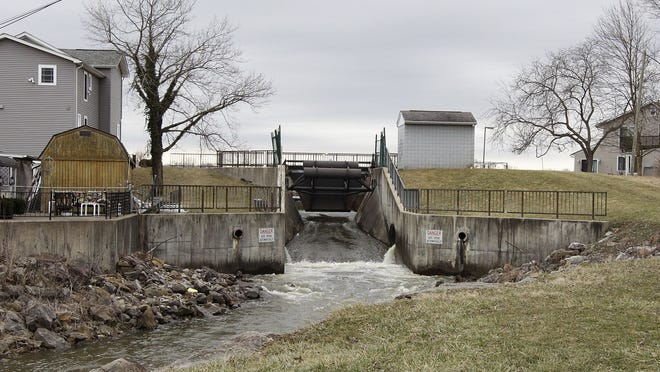 Water flows through a spillway Monday out of Buckeye Lake. The spillway is usually closed March 1 each year to allow the lake to fill with snowmelt and spring rains.