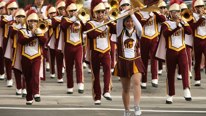 A portion of the USC Trojan marching band step off on the parade route during the 50th Annual Palm Desert Golf Cart Parade on Sunday, October 26, 2014 in Palm Desert, Calif. This year's theme is Palm Desert on Parade — Through the Decades '60s '70s '80s '90s and Present Day.