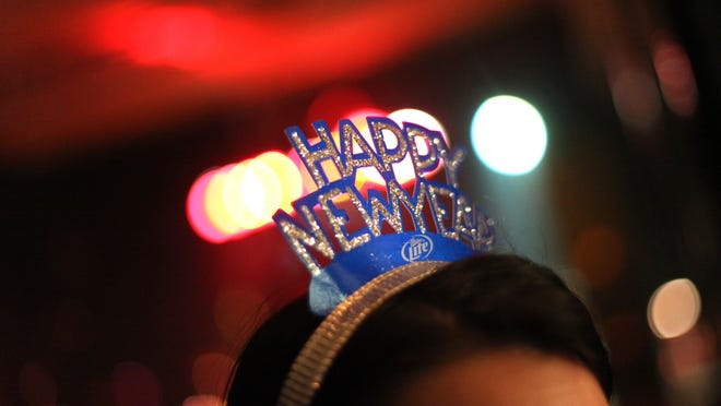 A partygoer celebrates New Year's Eve.