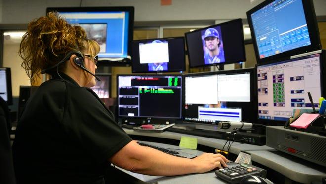 Visalia dispatcher Kim Mirelez works at the dispatch center for the Visalia Police Department.