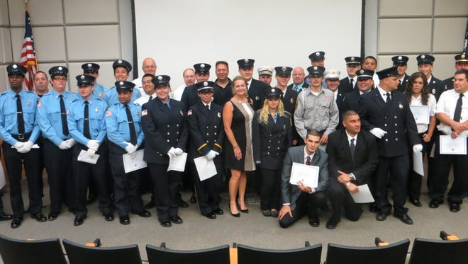 Putnam County Executive MaryEllen Odell is pictured with some of the 47 new Putnam County volunteer firefighters.