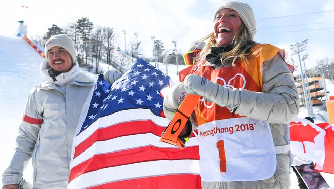 Jamie Anderson of the USA celebrates her gold-medal performance in snowboard slopestyle.