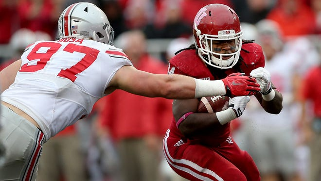 Indiana Hoosiers running back Devine Redding (34) looks to run by Ohio State Buckeyes defensive lineman Joey Bosa (97) in third quarter of their game. Ohio State defeated Indiana 34-27. Oct 3, 2015; Bloomington, IN, USA; [CAPTION] at Memorial Stadium. Mandatory Credit: Matt Kryger-USA TODAY Sports