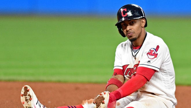 The Cleveland Indians' Francisco Lindor sits near second base after being forced out in a double play in the seventh inning.