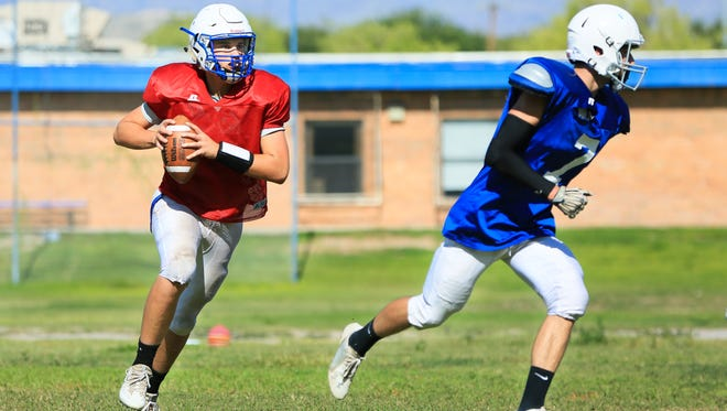 Mesilla Valley Christian quarterback Josh Castillo, left, and Brock Maddox prepare for a pass during practice on Monday at Mesilla Valley Christian School.