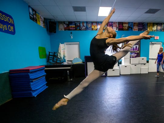 Fort Myers High School student Holland Tyson, 14, rehearses a dance routine for an upcoming competition under the watchful eye of dance instructor Robin Dawn.