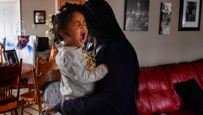 Laterra Logue holds her granddaughter, Shamari, as they prepare to eat breakfast Monday, Nov. 6, 2017, at their home in La Vergne. Logue is raising Shamari after her 19-year-old son was fatally shot in April.