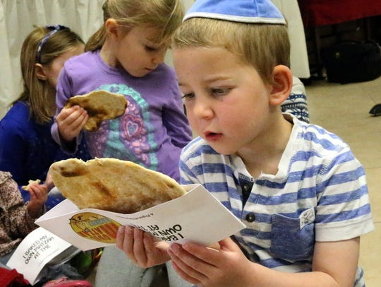 Menachem Greenberg, 5, gets ready to bite into his