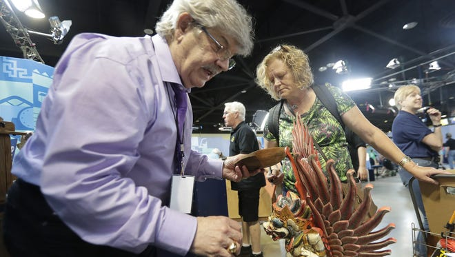 Antiques Roadshow tribal art expert John Buxton evaluates sculpted wood pieces from Bali and Papua New Guinea for owner Vicky V. of Pewaukee Saturday, June 17, 2017 when the PBS show visited the Resch Center in Ashwaubenon, WIs.