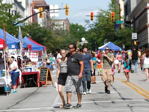 Main Street begins to fill with hungry patrons for the Taste of Tippecanoe Saturday, June 21, 2014, in downtown Lafayette. The Taste of Tippecanoe is the primary fundraiser for the Tippecanoe Arts Federation.