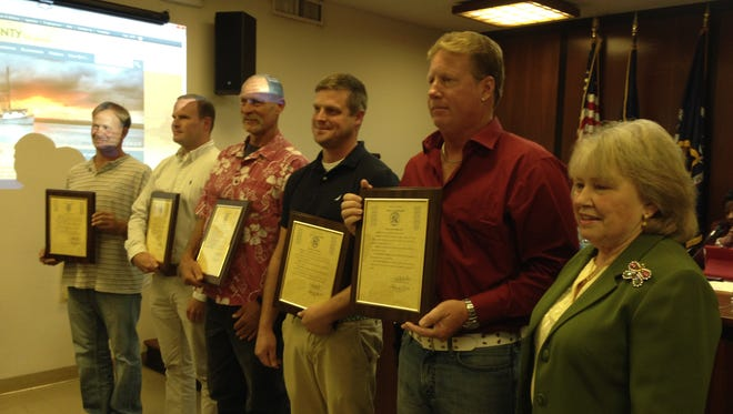 The Accomack County Board of Supervisors at their Oct. 21, 2015 meeting recognized five men who helped rescue two teenagers who nearly drowned while swimming off Assateague Island, Virginia on Sept. 30, 2015.