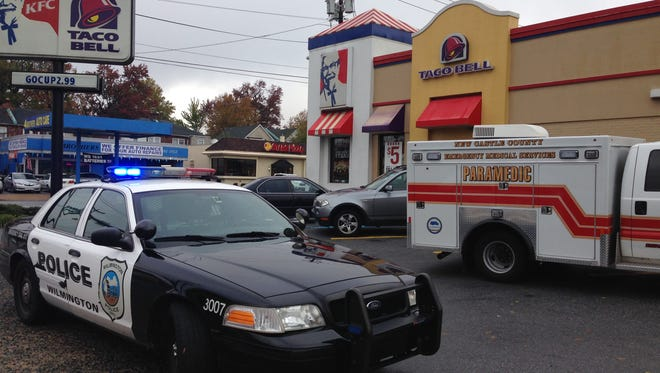 Wilmington police and New Castle County paramedics respond Thursday morning after a woman is found dead in the men's room of a KFC restaurant at Union Street and Lancaster Avenue.