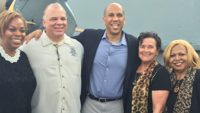 Democrats party Sunday night on the Battleship New Jersey in Camden at an opening reception for the Democratic National Convention. From left: Camden Mayor Dana Redd, reception sponsor state Senate President Stephen M. Sweeney, U.S. Sen. Cory Booker, Assemblywoman Patricia Egan Jones and  Redd's chief of staff, Novella Hinson.