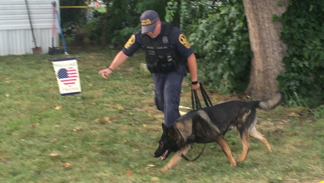 A Virginia State Police canine unit was brought in at the scene of shooting that left a man injured on North Bayard Avenue in Waynesboro on Monday, July 25, 2016.