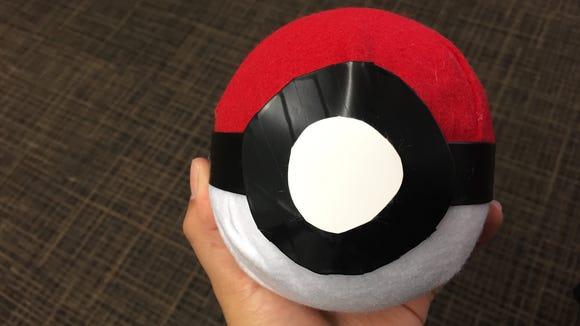 Make a Pokéball and hold your phone for a Pokémo Go costume.