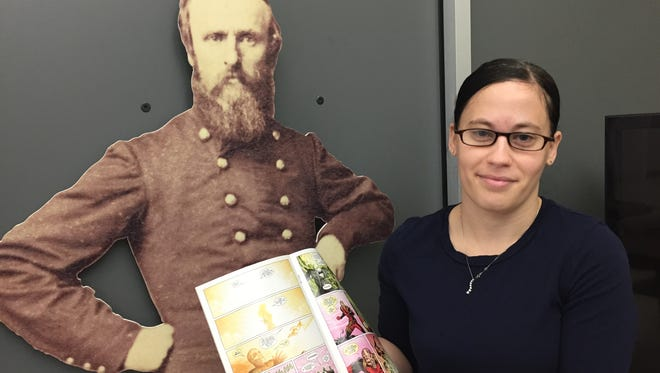 Rutherford B. Hayes Library and Museums Manuscript Assistant Julie Mayle shows a Deadpool comic featuring Hayes that will be on display during a popular culture exhibit beginning Feb. 3.