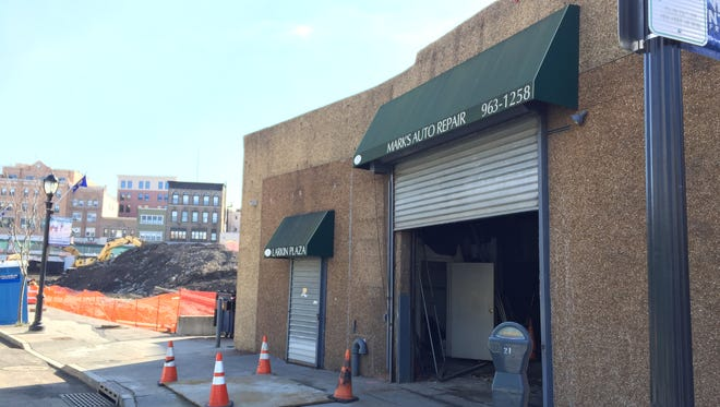 The auto body shop at 20 Nepperhan St. in Yonkers is the last building standing on a block targeted for redevelopment.