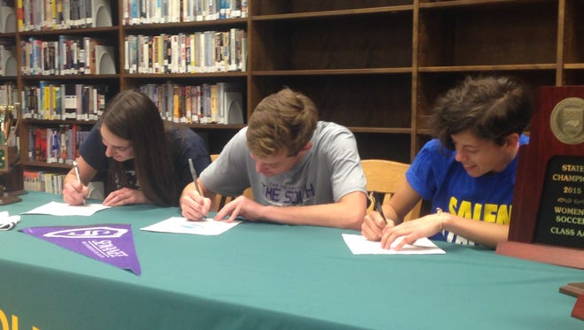 Reynolds seniors Katie Kearns, Brendan Mann and Ellie Montes, from left to right, have signed to play college soccer.
