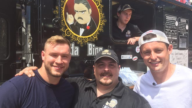 Nicholas Terzella, owner of Bada Bing food truck and soon to open Southern Tier Cheesesteak Co., with Washington Redskins Will Compton (left) and Tress Way (right)