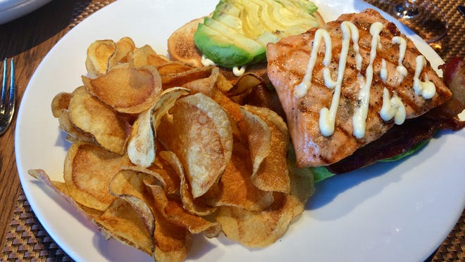 Grilled salmon BLT on toasted sourdough with house chips.