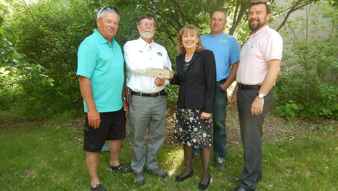 Walleyes for Tomorrow, Inc. representatives Gary Henschel, vice president, (left to right) and Mike Arrowood, board chair, present a check for $200,000 to UW-Stevens Point College of Natural Resources representatives Christine Thomas, dean,  Dan Isermann, director of UWSP's Wisconsin Cooperative Fishery Research Unit and Brian Sloss, associate dean for outreach and extension.