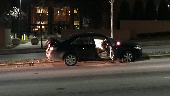 One of the cars involved in the accident that led to a shooting at the intersection of Martin Luther King Drive and Jefferson Avenue.