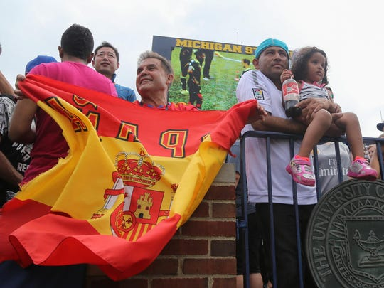 Fans wait for players to leave the field after the game on Saturday at Michigan Stadium. Real Madrid CF scored three early goals for the win.