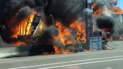 A semitruck fire erupts on Interstate 10 in Phoenix on May 25, 2018.